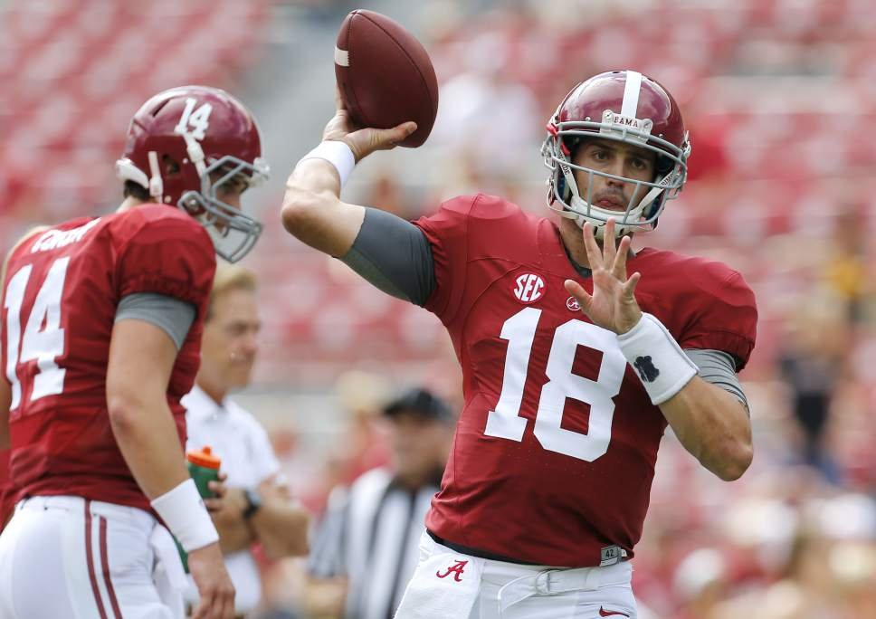 Alabama quarterback Cooper Bateman (18) warms up before an NCAA college football game against Louisiana Monroe in Tuscaloosa, Ala., Saturday, Sept. 26, 2015. (AP Photo/Jonathan Bachman)
