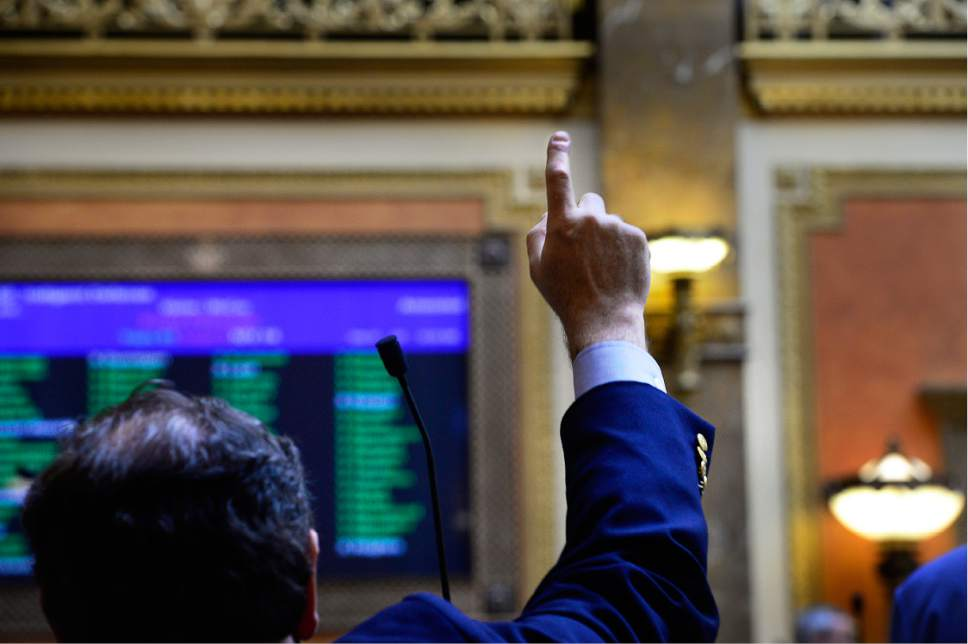 Scott Sommerdorf   |  Tribune file photo Rep. Brian King, D-Salt Lake City, votes in the Utah House of Representatives.