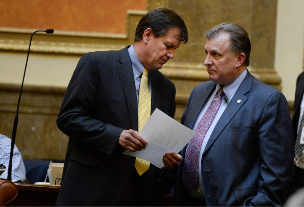 Francisco Kjolseth |  Tribune file photo Sen. Curtis Bramble, R-Provo, right, talks to Rep. Keven Stratton, R-Orem, left, in the House of Representatives.