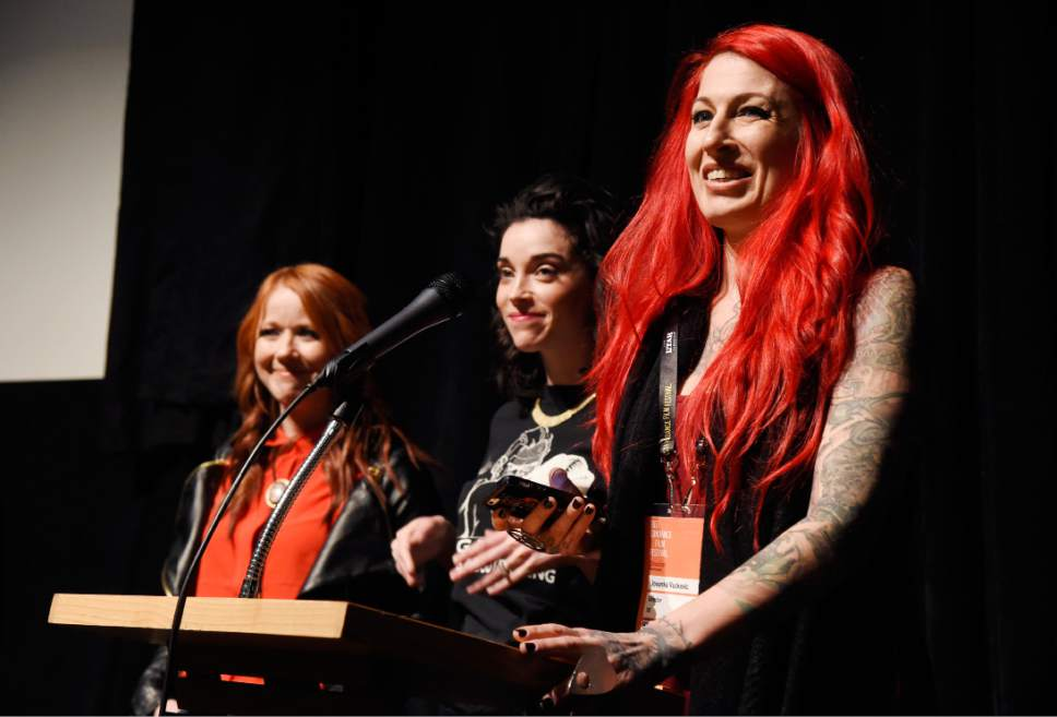 """Jovanka Vuckovic, right, one of the directors of """"XX,"""" introduces the film along with fellow directors Roxanne Benjamin, left, and Annie Clark at the premiere of the film at the Library Center Theatre during the 2017 Sundance Film Festival on Sunday, Jan. 22, 2017, in Park City, Utah. The film is a horror anthology featuing four female directors. (Photo by Chris Pizzello/Invision/AP)"""