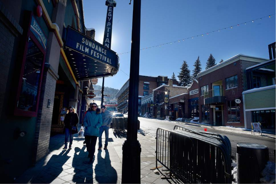 Scott Sommerdorf   |  The Salt Lake Tribune   Visitors pass The Egyptian Theatre on Main Street in Park City prior to the beginning of the Sundance Film Festival on Wednesday, Jan. 18, 2017.