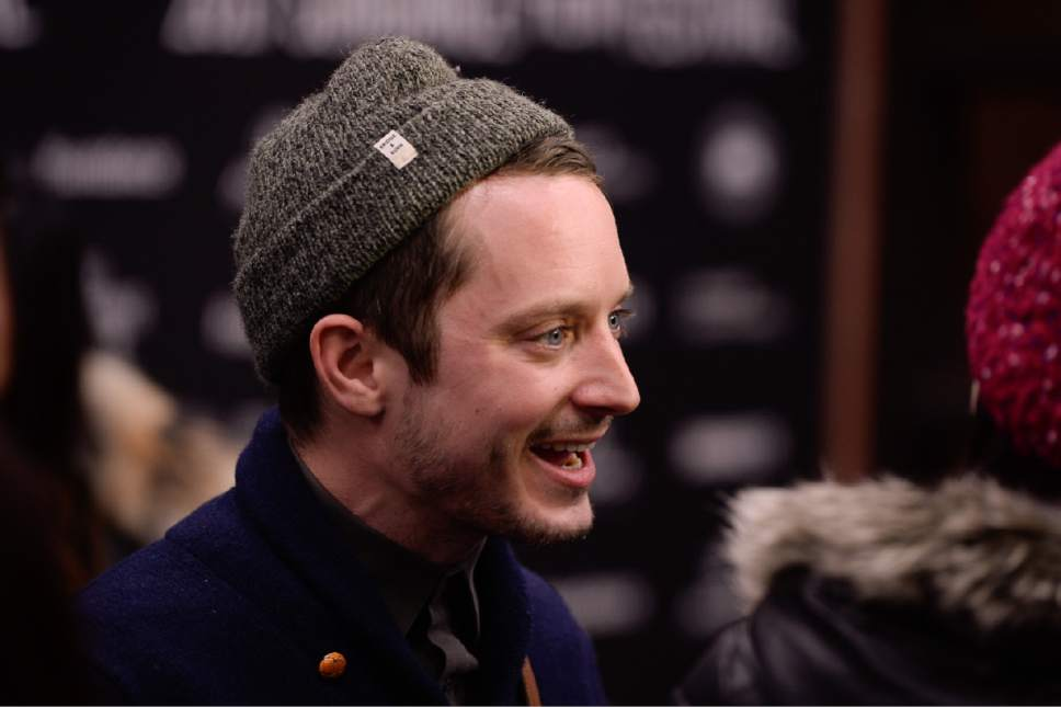 "Francisco Kjolseth | The Salt Lake Tribune Actor Elijah Wood walks the press line before the start of the debut of ""I Don't Feel at Home in This World Anymore,"" as it premieres on day one at the Sundance Film Festival in Park City on Thursday, Jan. 19, 2017."