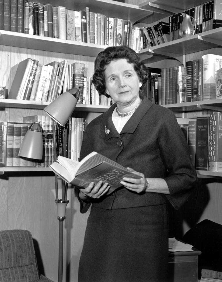 "Holding her controversial book ""Silent Spring,"" Rachel Carson stands in her library in Silver Springs, Md. on March 14, 1963.  She says she ""wanted to bring to public attention""  her charges that pestacides are destroying wildlife and endangering the environment.  (AP Photo)"