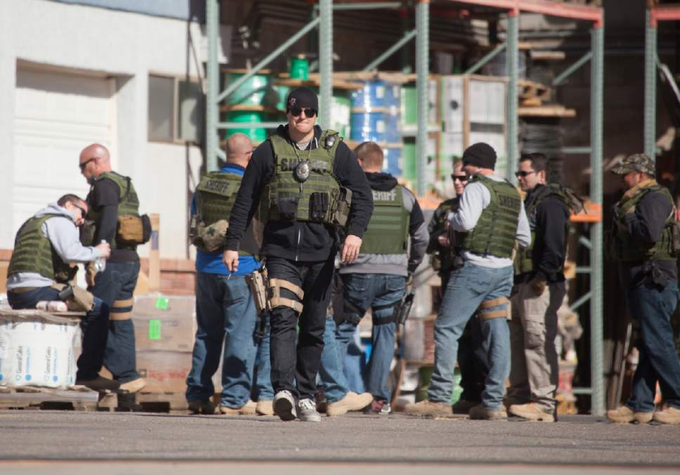 Law enforcement officers investigate in Hildale, Utah, Tuesday, Feb. 23, 2016. Several top leaders from Warren Jeffs' polygamous sect were arrested Tuesday on federal accusations of food stamp fraud and money laundering marking one of the biggest crackdowns on the group in years. (Chris Caldwell /The Spectrum & Daily News via AP)