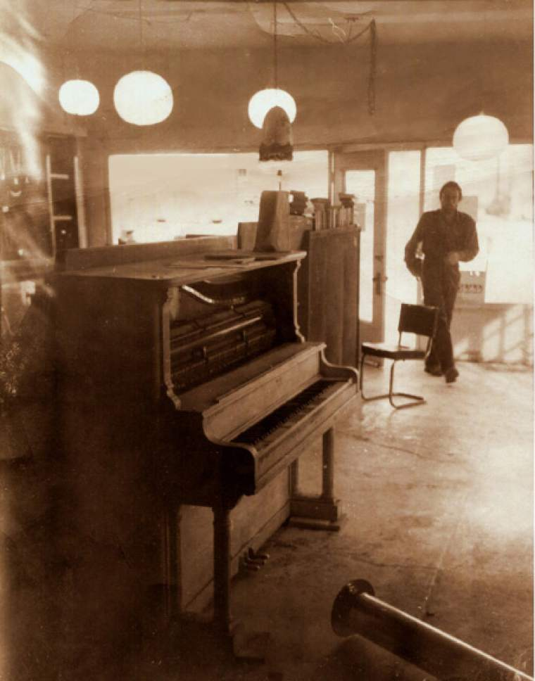 """photo courtesy Mike Evans  Steve Jones is seen with his """"public piano"""" was at the 366 S. West Temple Cosmic Aeroplane location. The store was at this site from 1974-1976."""
