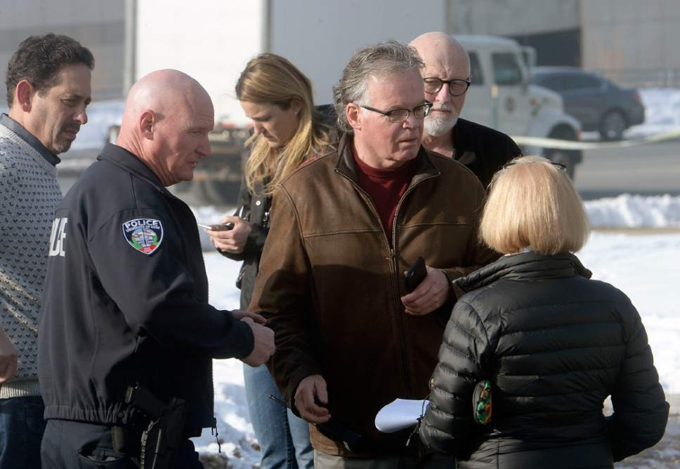 Al Hartmann  |  The Salt Lake Tribune Salt Lake City Police wait with staff members outside the Jewish Community Center Tuesday Jan 31 as a bomb threat is being investigated.   Pre-school and kindergarten students were evacuated to the University of Utah Hospital nearby.