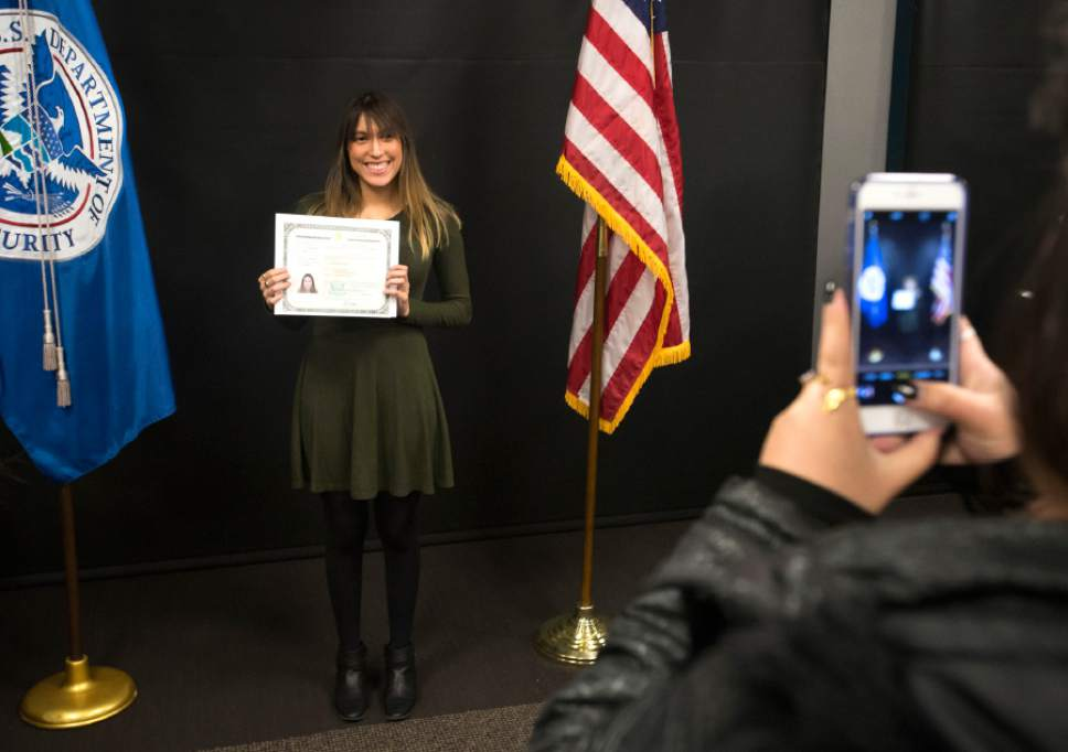 Rick Egan  |  The Salt Lake Tribune  Nancy Garmendez, originally from El Salvador, poses for photos after taking the Oath of Allegiance to become a U.S. citizen at the University of Utah College of Social Work Okazaki Community Meeting Room, Monday, January 30, 2017.