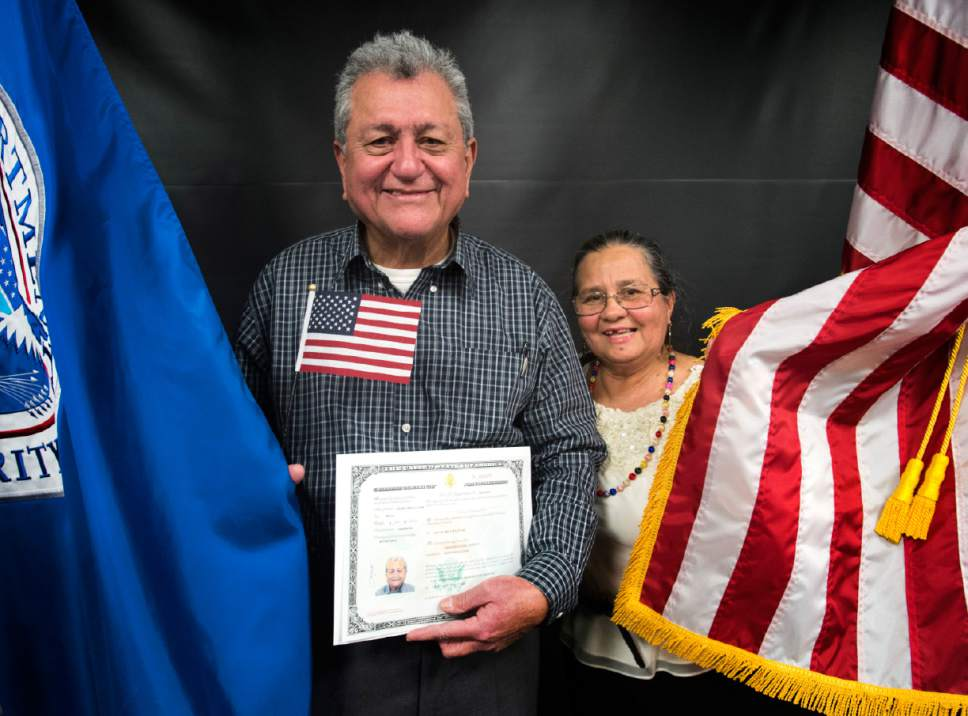 Rick Egan  |  The Salt Lake Tribune Aroldo Lainez poses for a photo with his wife Alicia, after his naturalization ceremony. Aroldo Lainez, originally from Honduras, and 29 other citizenship candidates from 14 countries took the Oath of Allegiance to become U.S. citizens at the University of Utah College of Social Work Okazaki Community Meeting Room, Monday, January 30, 2017.
