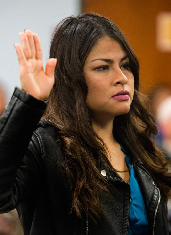 Rick Egan  |  The Salt Lake Tribune  Dulce Jacquelin Negreros takes the Oath of Allegiance at during a naturalization ceremony.  Negreros, originally from Mexico, and 29 other citizenship candidates from 14 countries took the Oath of Allegiance to become U.S. citizens at the University of Utah College of Social Work Okazaki Community Meeting Room, Monday, January 30, 2017.