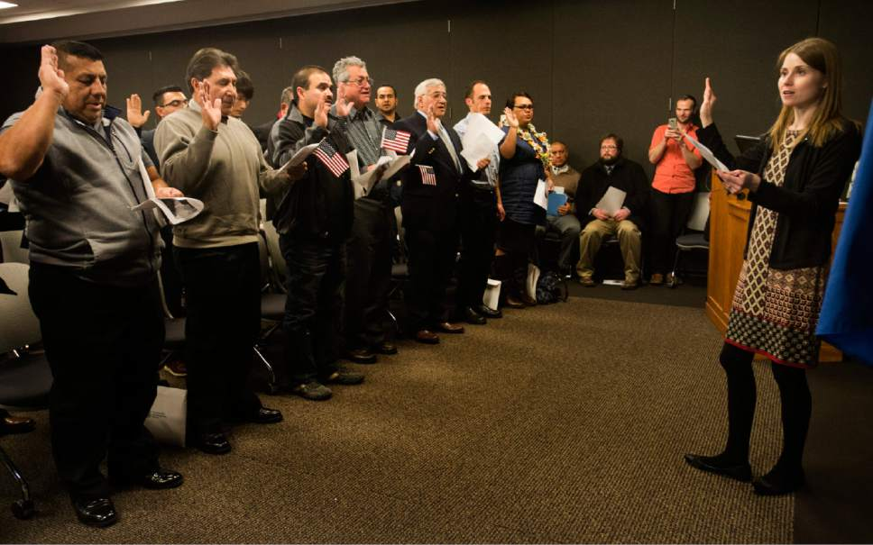 Rick Egan  |  The Salt Lake Tribune  Laura McNeer administers the Oath of Allegiance to 30 citizenship candidates from 14 countries at the University of Utah College of Social Work Okazaki Community Meeting Room, Monday, January 30, 2017.