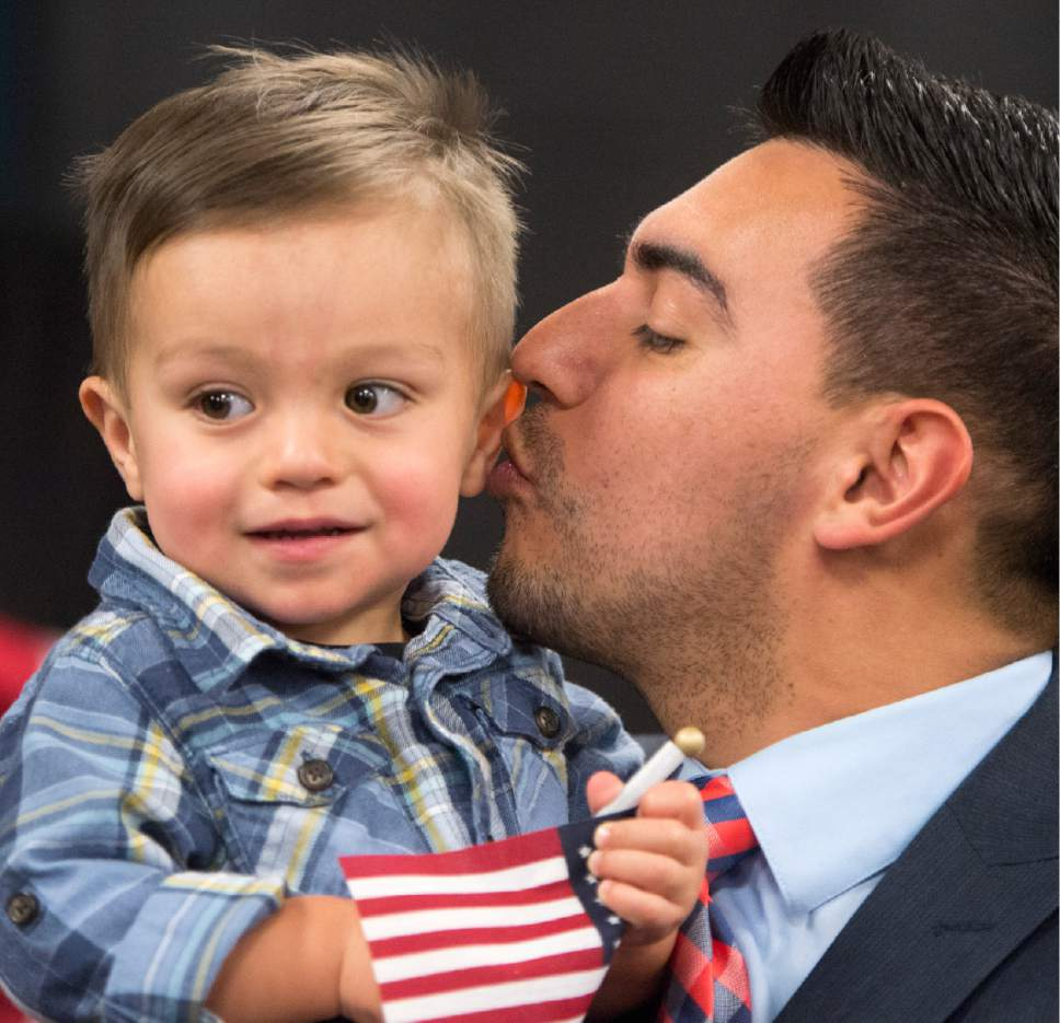 Rick Egan     The Salt Lake Tribune  Jeison Carrillo, Garland, kisses his son Greyson, after his naturalization ceremony.  Carrillo, originally from Costa Rica, and 29 other citizenship candidates from 14 countries took the Oath of Allegiance to become U.S. citizens at the University of Utah College of Social Work Okazaki Community Meeting Room, Monday, January 30, 2017.