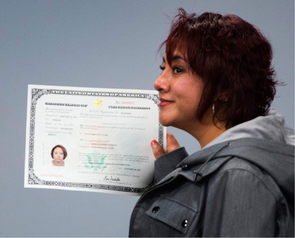 Rick Egan  |  The Salt Lake Tribune  Maria Vazquez, puts her certificate naturalization, after the ceremony.  Vazquez, from Mexico, and 29 other citizenship candidates from 14 countries took the Oath of Allegiance to become U.S. citizens at the University of Utah College of Social Work Okazaki Community Meeting Room, Monday, January 30, 2017.