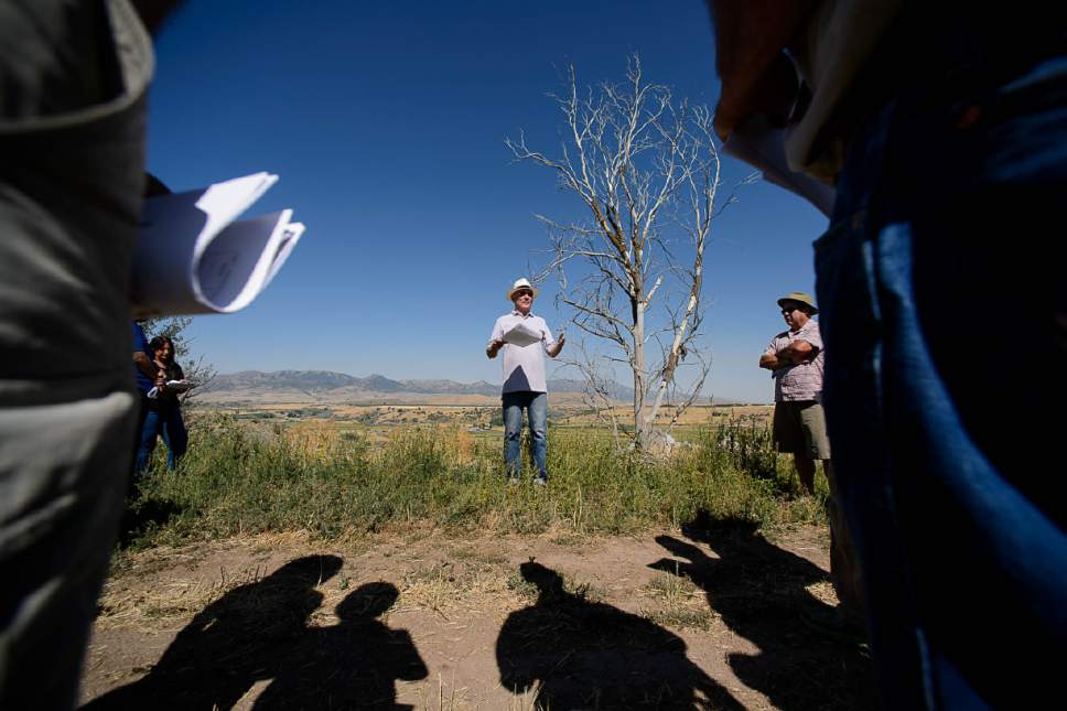 Trent Nelson  |  The Salt Lake Tribune Idaho State archaeologist Ken Reid, left, and Ken Cannon, right, explains their work to members of the  Idaho Historical Society at the site of the Bear River Massacre in Franklin County, Idaho, Tuesday August 9, 2016. Research is underway to determine precise locations of the Shoshone village US soldiers wiped out in a surprise attack Jan. 29, 1863. Some 300 to 500 Indians died in the attack, making it the West's worst massacre yet the event is little known.
