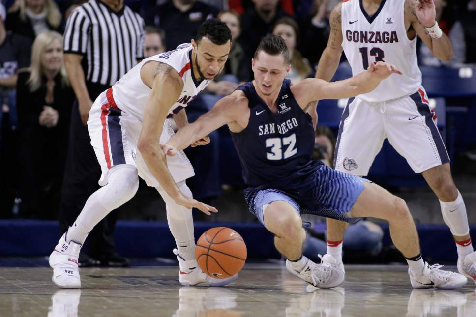 San Diego forward Brett Bailey (32) and Gonzaga guard Nigel Williams-Goss go after the ball during the first half of an NCAA college basketball game in Spokane, Wash., Thursday, Jan. 26, 2017. (AP Photo/Young Kwak)