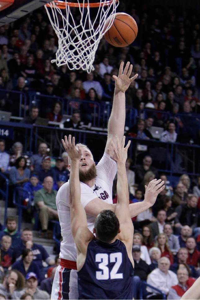 Gonzaga center Przemek Karnowski, left, shoots while defended by San Diego forward Brett Bailey (32) during the second half of an NCAA college basketball game in Spokane, Wash., Thursday, Jan. 26, 2017. Gonzaga won 79-43. (AP Photo/Young Kwak)