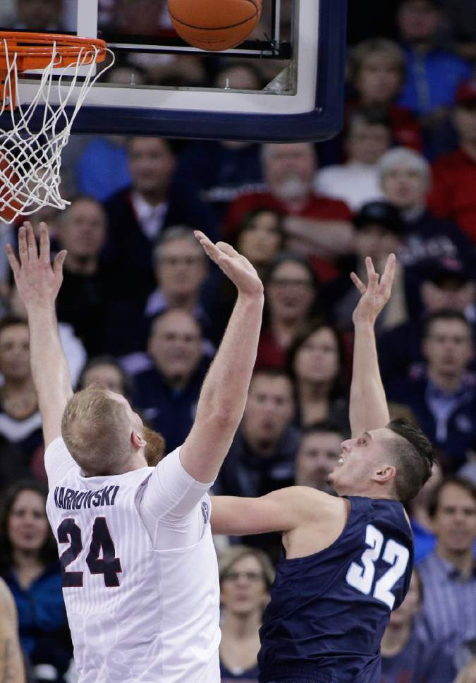 San Diego forward Brett Bailey (32) shoots while defended by Gonzaga center Przemek Karnowski (24) during the first half of an NCAA college basketball game in Spokane, Wash., Thursday, Jan. 26, 2017. (AP Photo/Young Kwak)