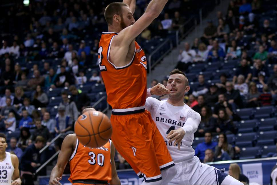 Brigham Young Cougars guard Nick Emery (4) passes the ball behind the back of a Pepperdine player during a BYU home basketball game against Pepperdine University on Thursday, Jan. 19, 2017 at the Marriott Center in Provo. (Dominic Valente/The Daily Herald via AP)