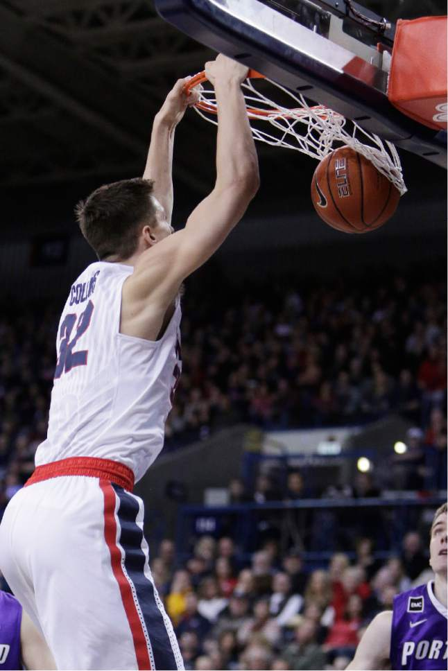 Gonzaga forward Zach Collins (32) dunks during the first half of the team's NCAA college basketball game against Portland in Spokane, Wash., Saturday, Jan. 21, 2017. (AP Photo/Young Kwak)