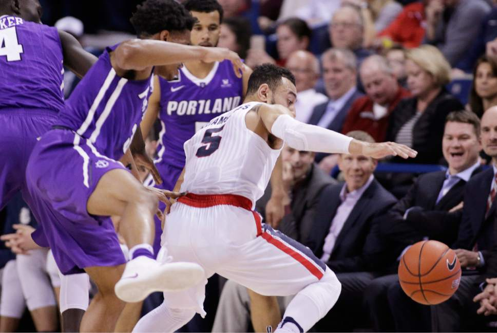 Gonzaga guard Nigel Williams-Goss (5) and Portland guard Rashad Jackson, left, go after the ball during the first half of an NCAA college basketball game in Spokane, Wash., Saturday, Jan. 21, 2017. (AP Photo/Young Kwak)