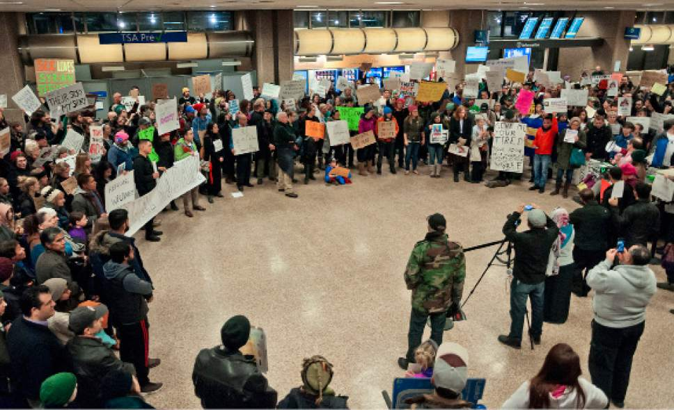 Michael Mangum  |  Special to the Tribune  Crowds of people protested at the Salt Lake City International Airport on Saturday, January 28, 2017 Hundreds gathered to stand in solidarity against President Trump's executive order on immigration, among many other social topics.