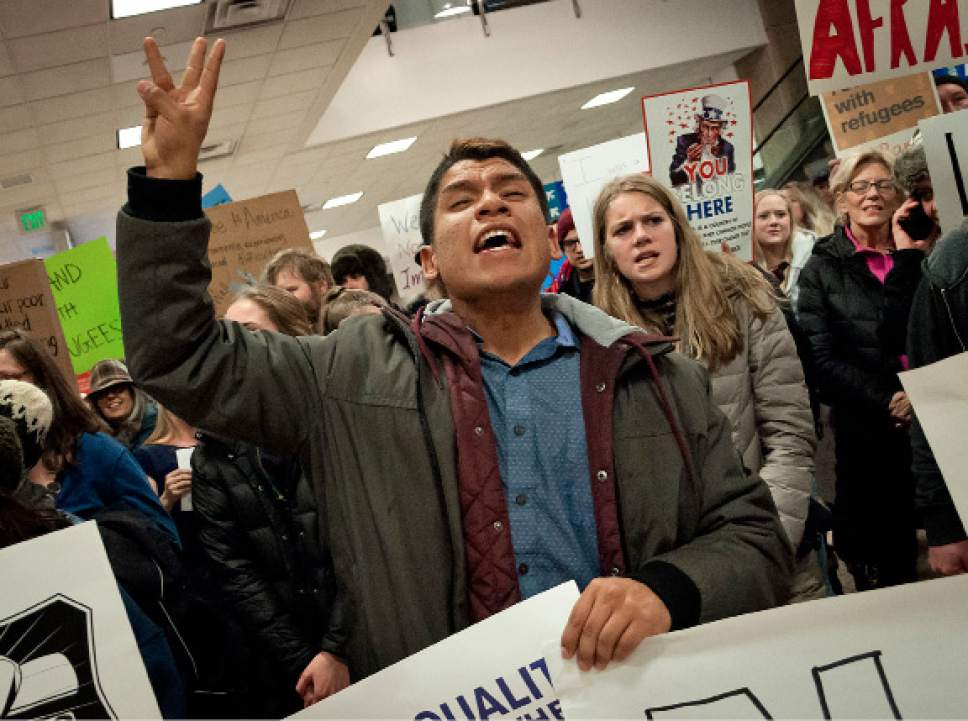 Michael Mangum  |  Special to the Tribune  Cristobal Villegas, of Mapleton, chants loudly with the crowd during a protest at the Salt Lake City International Airport on Saturday, January 28, 2017. Villegas said he came in support of those in the underrepresented communities such as immigrants and LGBT. Hundreds gathered to protest President Trump's executive order on immigration, among many other social topics.
