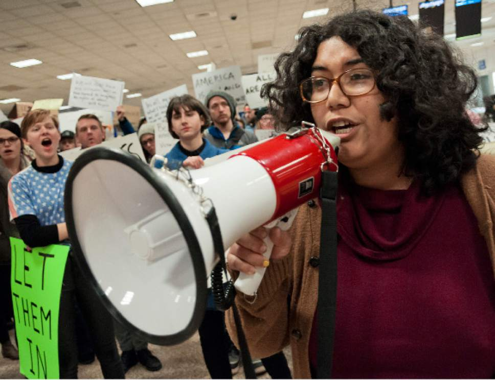 Michael Mangum  |  Special to the Tribune  Ella Mendoza, a woman who identified herself as an undocumented immigrant from Peru, speaks to the crowd during a protest at the Salt Lake City International Airport on Saturday, January 28, 2017. Hundreds gathered to protest President Trump's executive order on immigration, among many other social topics.