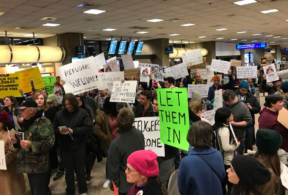 Michael Mangum  |  Special to the Tribune  People gather at Salt Lake City International Airport to protest President Donald Trump's immigration order Saturday, Jan. 28, 2017.