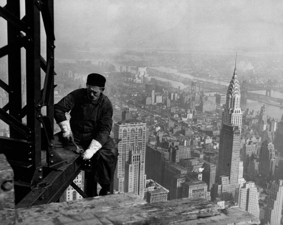 """Workman on the framework of the Empire State Building, New York City, ca. 1930-31. The photo is part of the Smithsonian traveling exhibition, """"The Way We Worked,"""" on display Jan. 28-March 19 at Ogden's Union Station. National Archives  