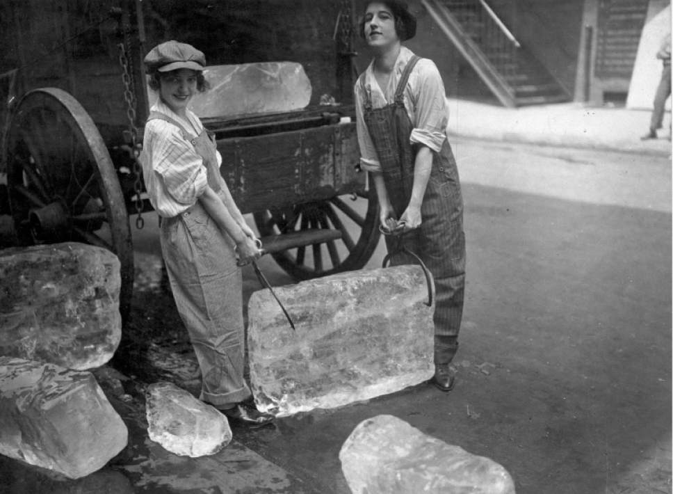 """Young women delivering ice, 1918. The photo is part of the Smithsonian traveling exhibition, """"The Way We Worked,"""" on display Jan. 28-March 19 at Ogden's Union Station. National Archives  