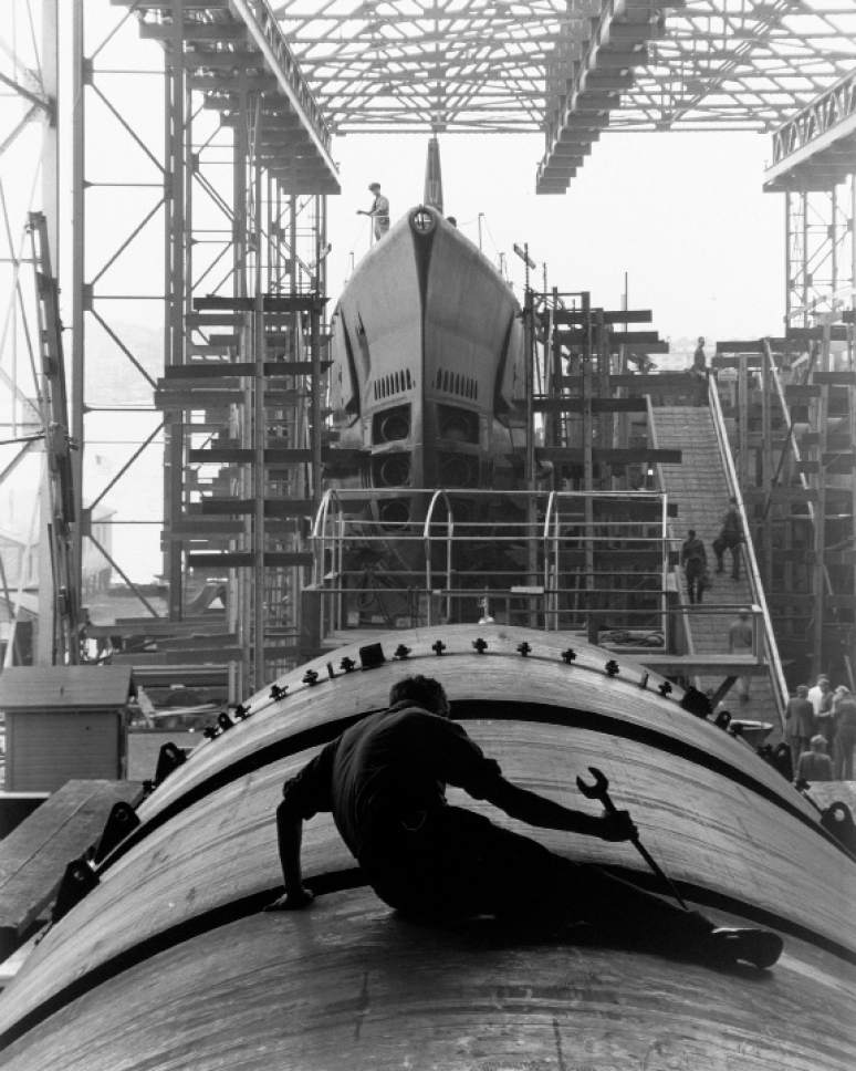 """A submarine builder at Electric Boat Company, Groton, Connecticut, by Fenno Jacobs, August 1943. The photo is part of the Smithsonian traveling exhibition, """"The Way We Worked,"""" on display Jan. 28-March 19 at Ogden's Union Station. National Archives  