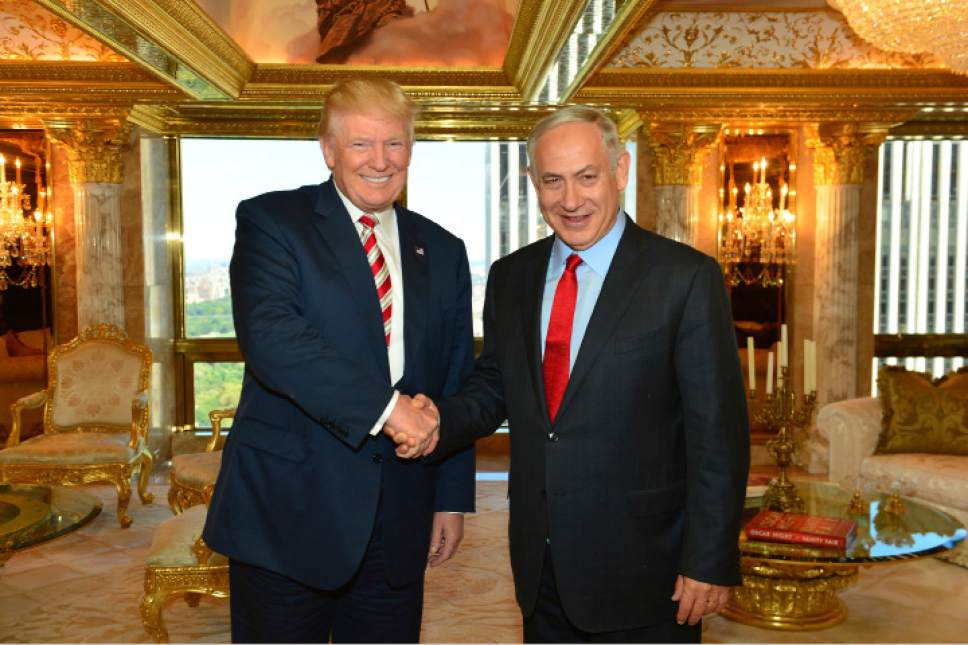 In this handout photo made on Sunday, Sept. 25, 2016, provided by the Israeli Government Press Office, Republican Presidential candidate Donald Trump shakes hand with Israeli Prime Minister Benjamin Netanyahu in New York. Netanyahu's upcoming White House visit aims to cement ties to a surprisingly supportive U.S. president _ but it also presents a political minefield. Israel's nationalist leader this week upset Mexico with a tweet supporting President Trump's border wall, stayed sheepishly silent while American Jewish groups condemned an awkward White House statement ignoring the Jewish element of the Holocaust, and saw many Mideast-born Israelis fret the controversial U.S. new refugee ban might affect them as well. (Kobi Gideon,GPO via AP)