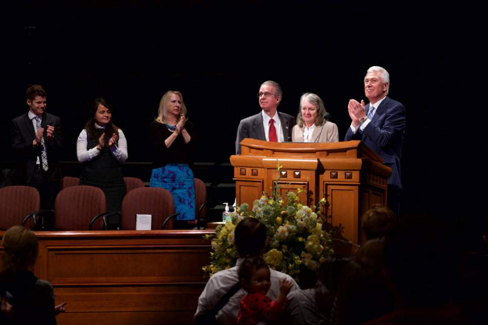 Courtesy  |  LDS Church  President Dieter F. Uchtdorf of the First Presidency of The Church of Jesus Christ of Latter-day Saints is joined by J. Lawrence Richards and his wife, Julie, at the Conference Center in Salt Lake City, January 31, 2017. Richards is completing his service as president of LDS Business College. He will be succeeded by Dr. Bruce C. Kusch.