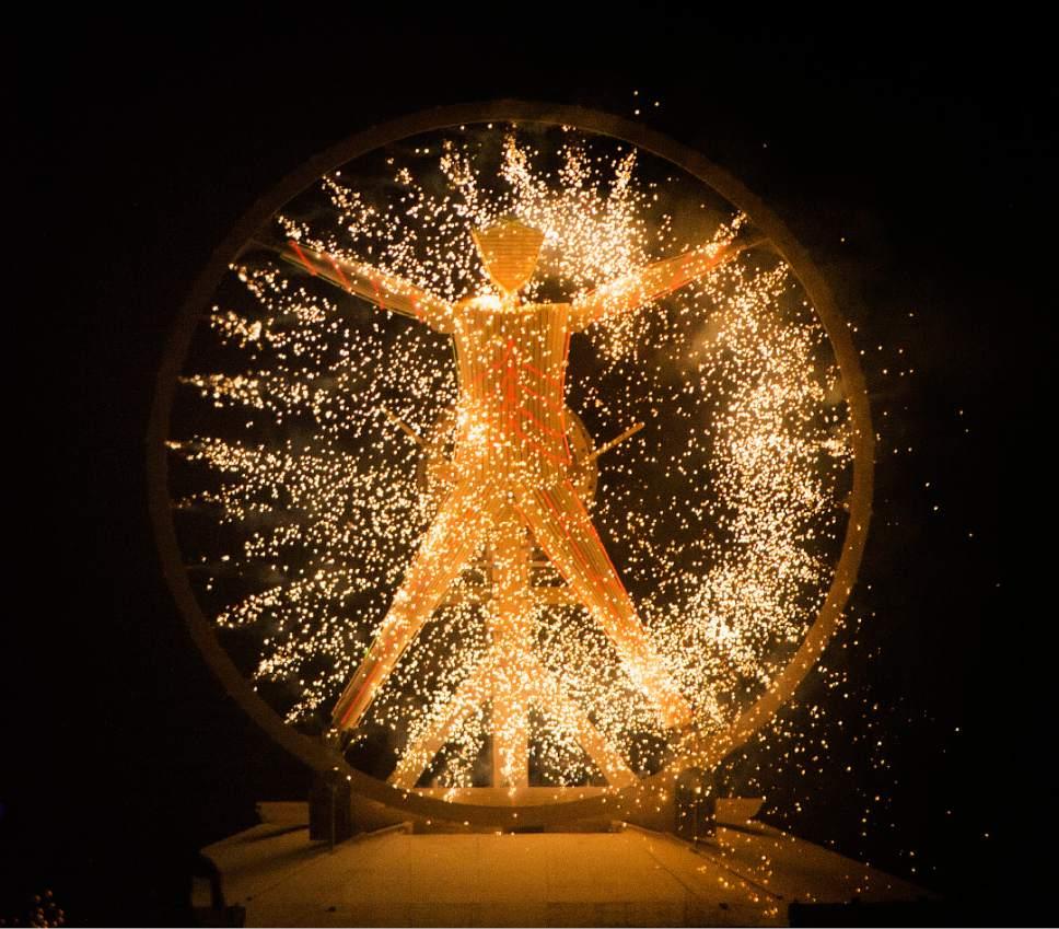 Rick Egan  |  The Salt Lake Tribune  Sparks fly as the Burning Man ignites at the Burning Man Festival, in the Black Rock Desert 100 miles north of Reno Nevada, Saturday, September 3, 2016.