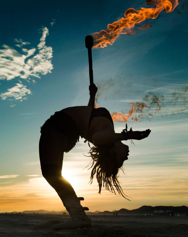 Rick Egan  |  The Salt Lake Tribune  Darlene VonMaschmeyer, Santa Cruz, CA, dances with fire at sunrise, at the Burning Man Festival ,in the Black Rock Desert, 100 miles north of Reno, NV, Saturday, September 3, 2016.
