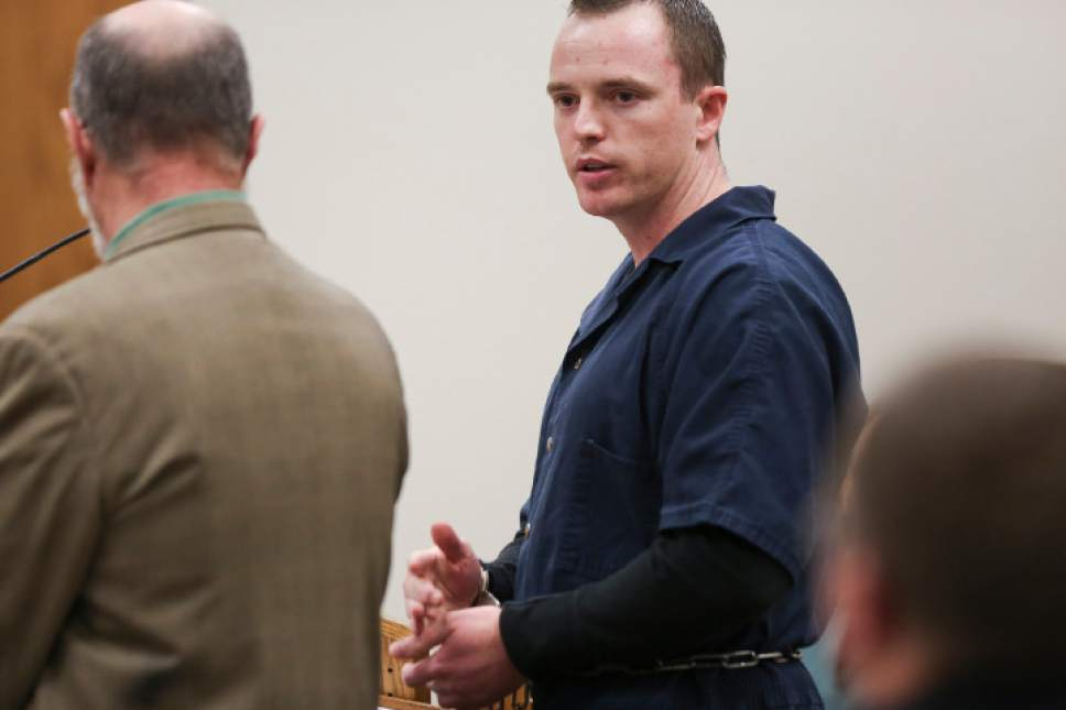 (Spenser Heaps     Pool) Conrad Truman, standing beside his defense attorney Ron Yengich, looks back toward the prosecution and the courtroom while addressing the court during the sentencing phase of his trial at the Fourth District Court in Provo on Monday, Feb. 9, 2015. Truman was sentenced to consecutive sentences of 15 years to life for murder and one to 15 years for obstruction of justice in the 2012 shooting death of his wife Heidy Truman.