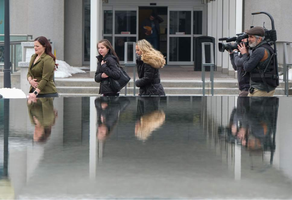 Francisco Kjolseth | The Salt Lake Tribune Jessica Christensen, Shannel DeRieux and Amanda Peterson, from left, who all grew up in polygamous families, are followed around by a film crew as part of the reality show, Escaping Polygamy. The three were at the Utah Capitol on their way to catch a hearing for HB99, which clarifies polygamy is a felony in Utah on Wednesday, Feb. 1, 2017.