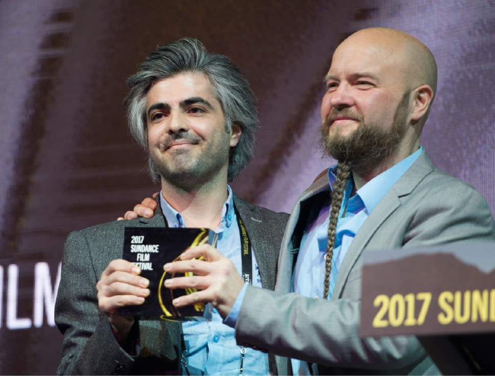 "Rick Egan  |  The Salt Lake Tribune   Director Feras Fayyad receives the World Cinema Grand Jury Prize: Documentary ""Last Men in Aleppo,"" at the 2017 Sundance Film Festival's Awards Ceremony, Saturday, January 28, 2017."