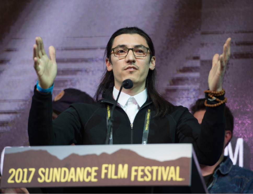 "Rick Egan  |  The Salt Lake Tribune   Jeff Orlowski  receives the Audience Award: U.S. Documentary, for ""Chasing Coral,"" at the 2017 Sundance Film Festival's Awards Ceremony, Saturday, January 28, 2017."
