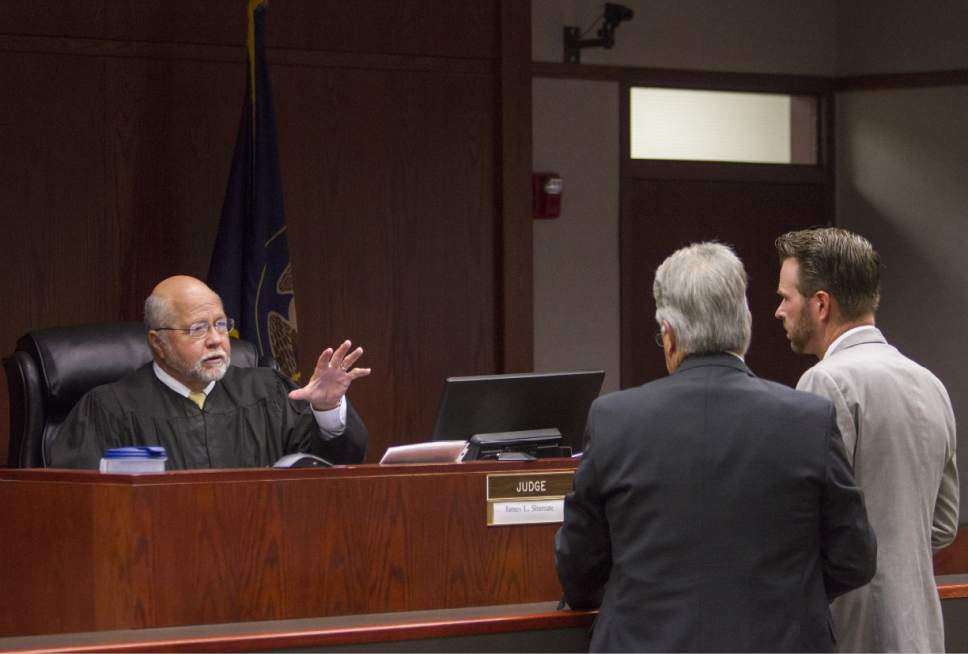 Judge James Shumate (left) talks with Douglas Terry (middle) and Mike Edwards (right) during the State of Utah v. Sorensen trial at the Fifth District Court in Cedar City on Wednesday, Oct. 26, 2016.