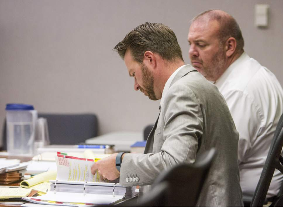 Mike Edwards (left), deputy county attorney, reviews his notes during the State of Utah v. Sorensen trial at the Fifth District Court in Cedar City on Wednesday, Oct. 26, 2016.