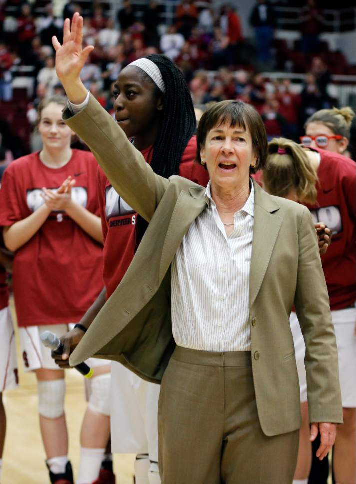 FILE - In this Dec. 14, 2013, file photo, Stanford coach Tara VanDerveer waves to fans after a ceremony in recognition of her 900 career wins, after the team's NCAA college basketball game against Gonzaga in Stanford, Calif. On Friday night when No. 8 Stanford hosts USC, Vanderveer is poised to become just the second NCAA women's coach to enter the 1,000 wins club, alongside the late Pat Summitt. (AP Photo/Ben Margot, File)