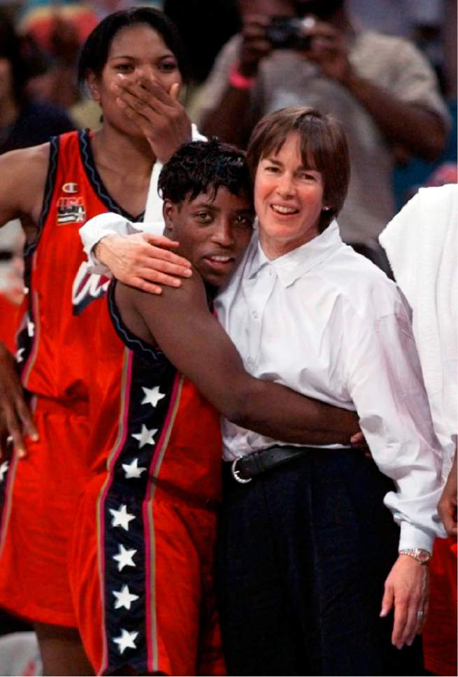 FILE - In this Aug. 4, 1996, U.S. women's basketball coach Tara VanDerveer, right, hugs Ruthie Bolton, as Venus Lacey watches the action on the court during the final moments of the gold metal women's basketball game against Brazil at the Summer Olympic Games in Atlanta. On Friday night when No. 8 Stanford hosts USC, Vanderveer is poised to become just the second NCAA women's coach to enter the 1,000 wins club, alongside the late Pat Summitt. (AP Photo/Eric Draper, File)