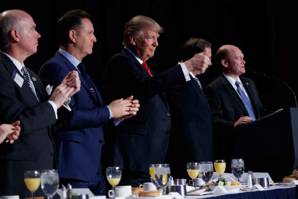 President Donald Trump gives a thumbs up during the National Prayer Breakfast, Thursday, Feb. 2, 2017, in Washington. (AP Photo/Evan Vucci)