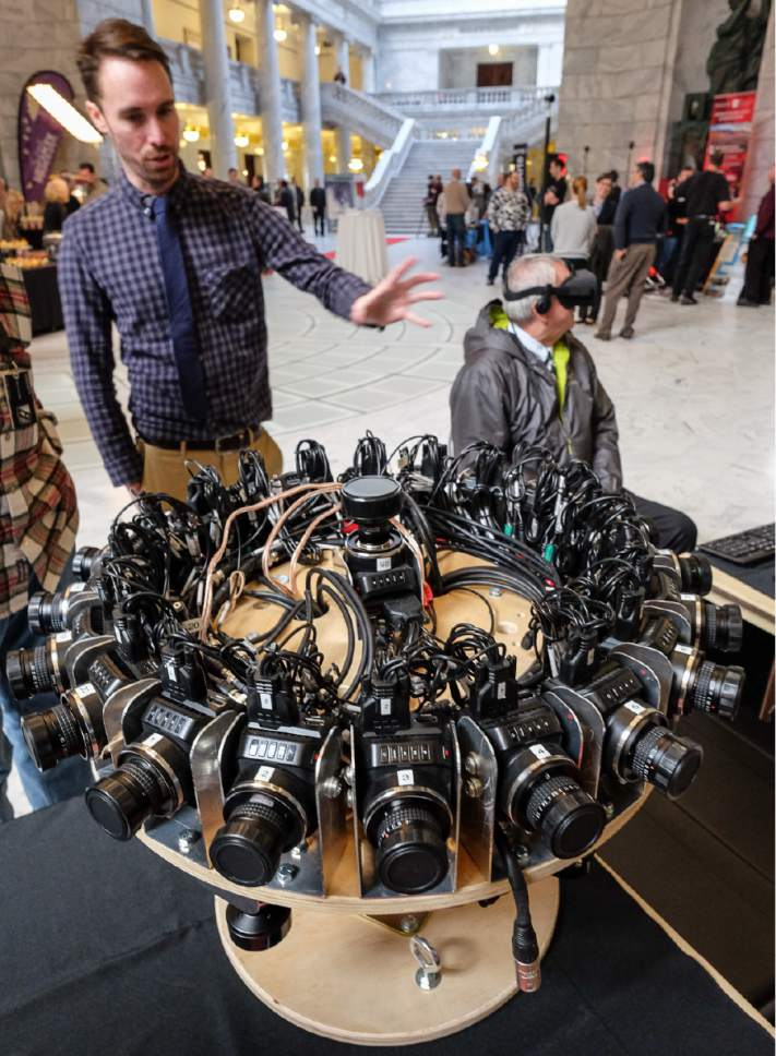 "Francisco Kjolseth | The Salt Lake Tribune Chris Nielsen, virtual reality project manager for Cosmic, shows off a rig holding 25 Black Magic micro cinema cameras used to film 360 degree video. ""Film Day on the Hill,"" brought in the Utah Film Commission and other film-related groups to tout to the Legislature all the cool things they do to bring film production into the state."
