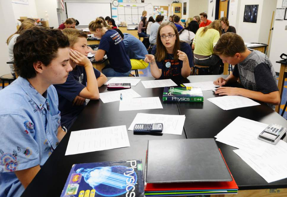 Steve Griffin  | Tribune file photo Sarah Carlson  with her physics students during class at Brighton High School in Cottonwood Heights. According to a new poll, Utahns are divided about starting high school classes as late as 8:30 a.m. in spite of evidence of health and educational benefits.