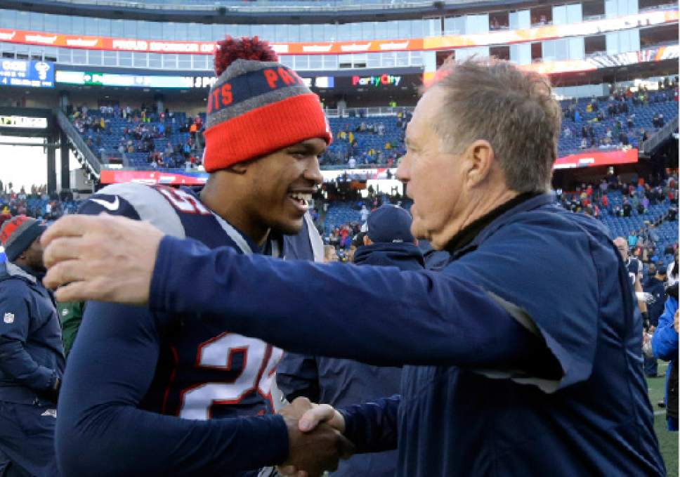 New England Patriots head coach Bill Belichick, right, speaks to defensive back Eric Rowe at midfield following an NFL football game against the New York Jets, Saturday, Dec. 24, 2016, in Foxborough, Mass. (AP Photo/Elise Amendola)