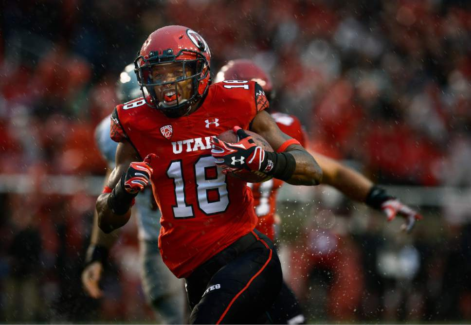 Scott Sommerdorf   |  The Salt Lake Tribune Utah DB Eric Rowe glides into the end zone with an interception to give Utah a very quick 7-0 lead. Utah took a 21-0 lead over Washington State in the first quarter, Saturday, September 27, 2014.
