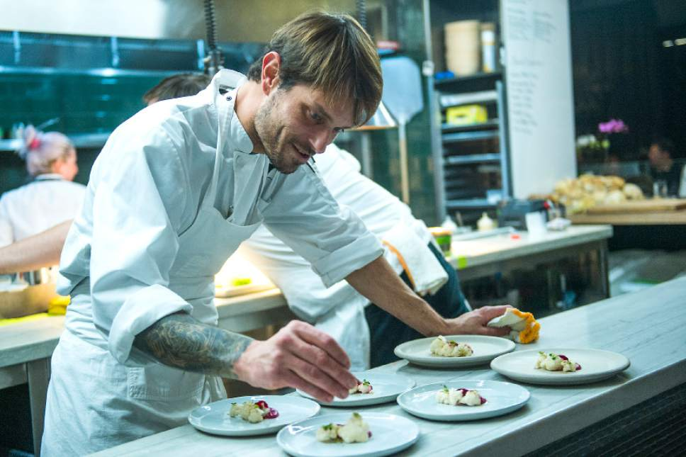 Chris Detrick  |  The Salt Lake Tribune Chef and co-owner Nick Fahs prepares plates of red beet curry with cauliflower, coconut and spices at Table X in Millcreek.