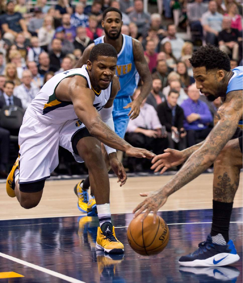 Lennie Mahler  |  The Salt Lake Tribune  Utah Jazz guard Joe Johnson is unable to come up with the loose ball against Denver's Wilson Chandler in the first half of a game at Vivint Smart Home Arena in Salt Lake City, Saturday, Dec. 3, 2016.