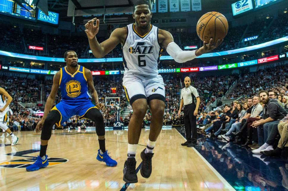 Chris Detrick  |  The Salt Lake Tribune Utah Jazz forward Joe Johnson (6) saves the ball from going out of bounds past Golden State Warriors forward Kevin Durant (35) during the game at Vivint Smart Home Arena Thursday December 8, 2016.